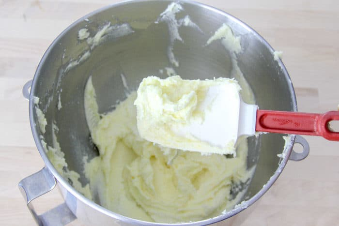 Cream together the butter and sugar in a bowl until light and fluffy