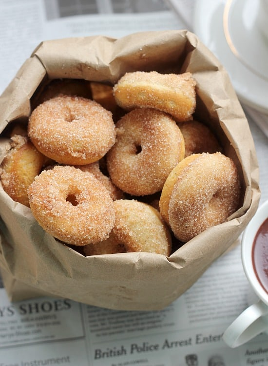 Cinnamon sugar mini baked donuts in a paper bag