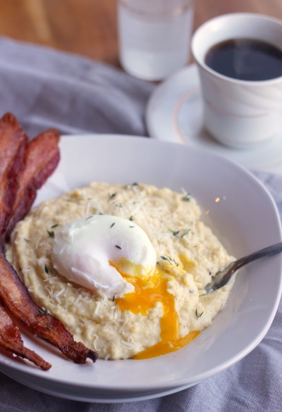Creamy Breakfast Polenta with Asiago, Thyme, Bacon, and Poached Eggs- Baker Bettie