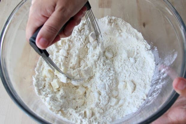 Cutting butter through the flour for drop biscuits.