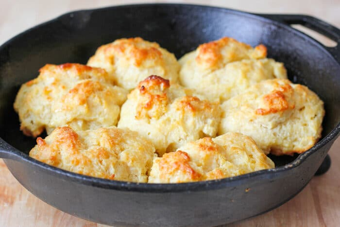 Drop biscuits in a cast iron skillet after being baked.