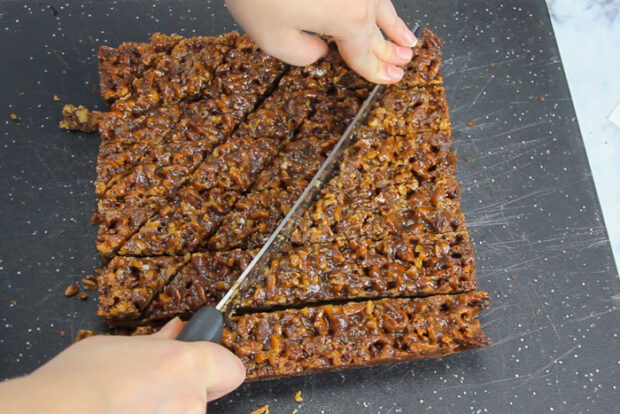 Showing how to slice on a diagonal to make pecan diamonds