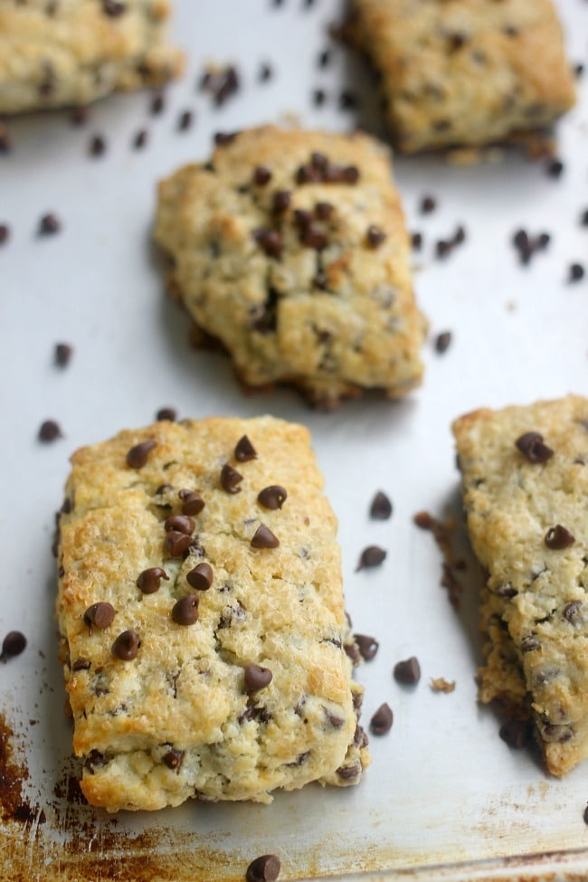 These chocolate chip scones are fluffy, flaky and tender! The scones are slightly sweet, filled with mini chocolate chips, and topped with crunchy coarse sugar!
