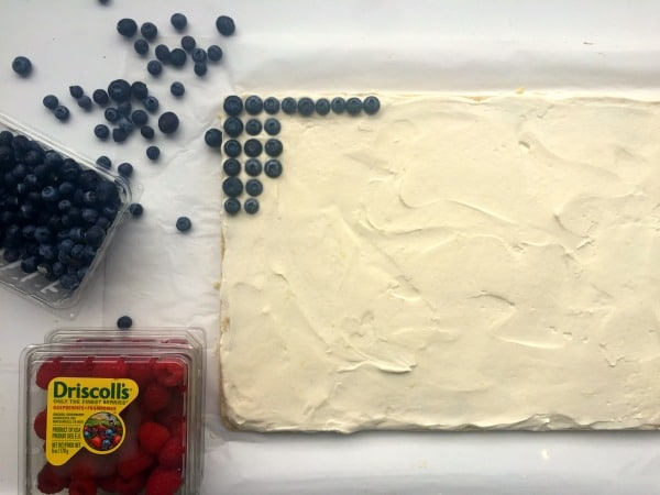 Decorating the American flag cookie cake