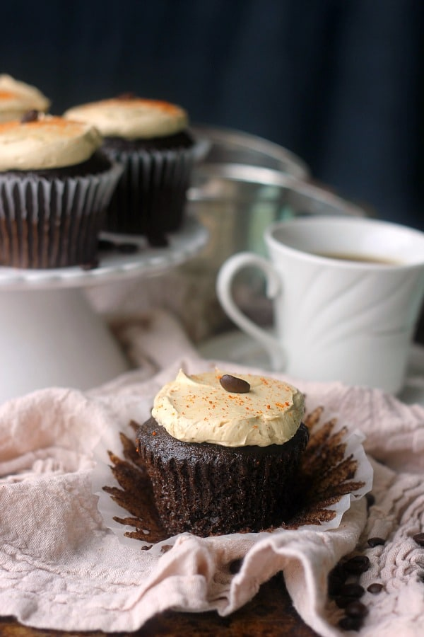 Chili mocha cupcakes start with a rich chocolate cake spiced with cayenne pepper, smoked paprika, and cinnamon! They are then topped with an espresso buttercream and a sprinkle of cayenne for a little extra spice!