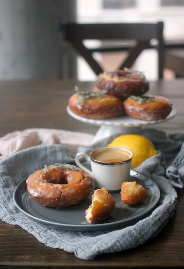 Lemon Thyme Old Fashioned Donuts are made with lots of egg yolks and sour cream and fried at a lower temperature to help get that crackly donut top! They are tangy, herbacious, slightly sweet, and so good with a strong cup of coffee!