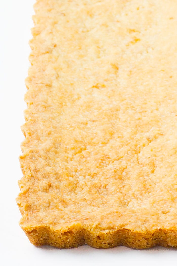 Baked shortbread crust, sable breton, to use for tarts, cheesecake, and cookie bars.
