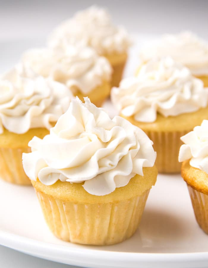 Yellow cupcakes iced with vanilla buttercream frosting