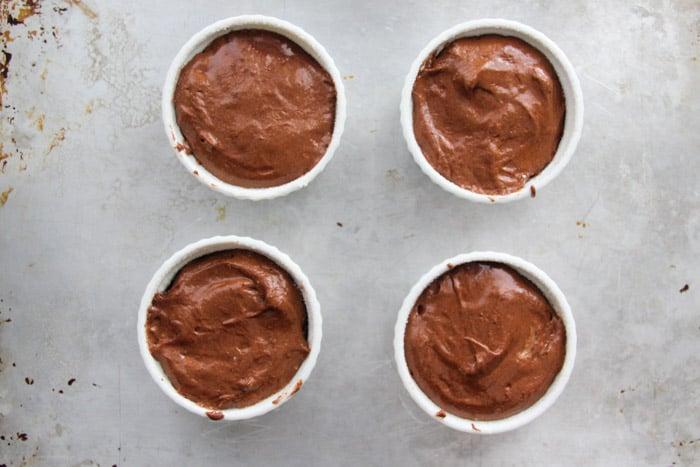 Prepared souffle batter in ramekins ready to be baked