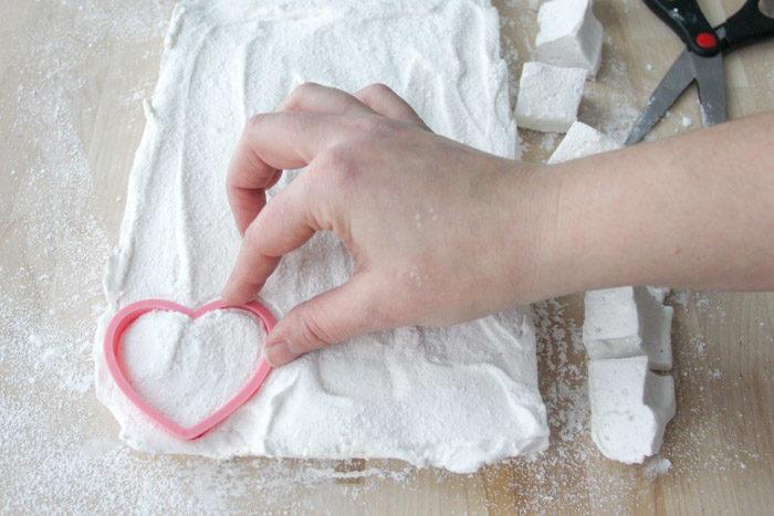 Cutting shapes into marshmallows, heart shape cutter