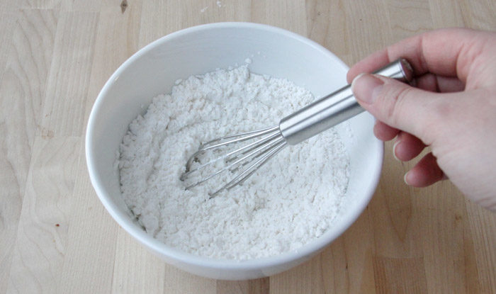 Cornstarch and powdered sugar whisked together in bowl