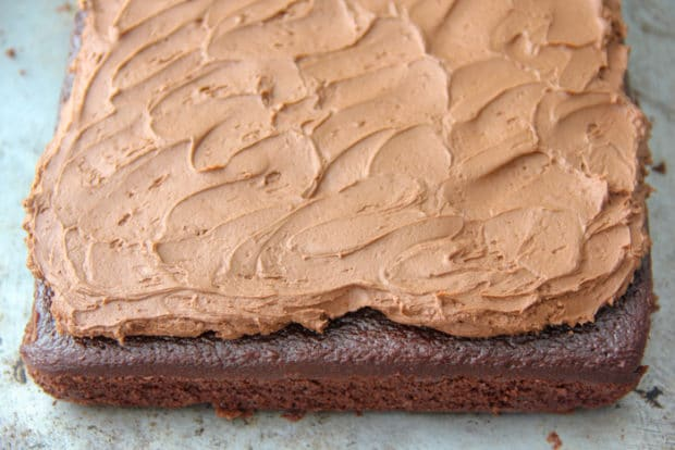 Sheet cake decorated with thick layer chocolate buttercream