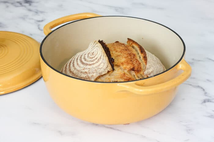 Loaf of sourdough bread in a dutch oven