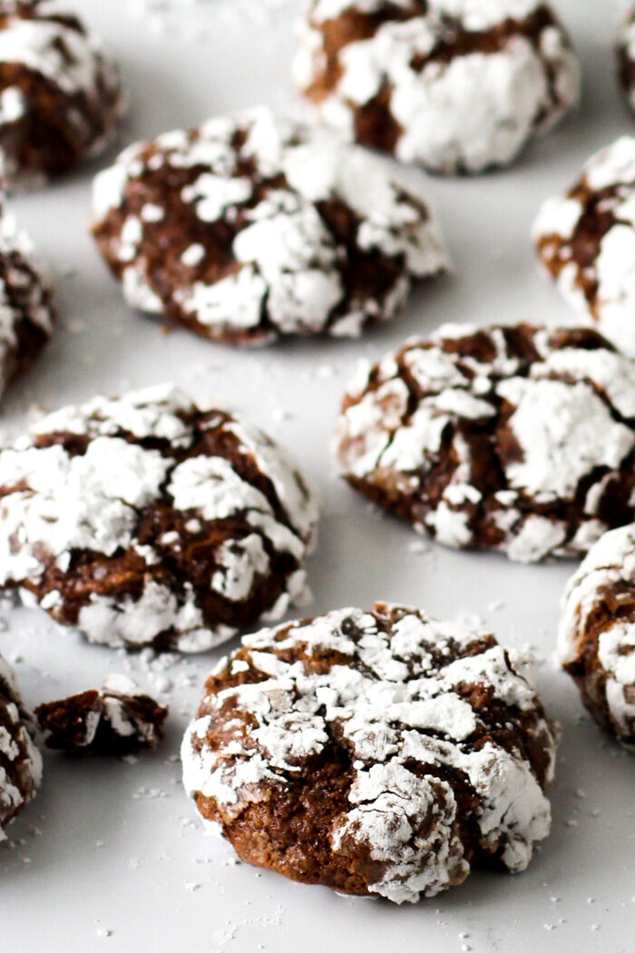 Baked chocolate crinkle cookies lined up for a beauty shot