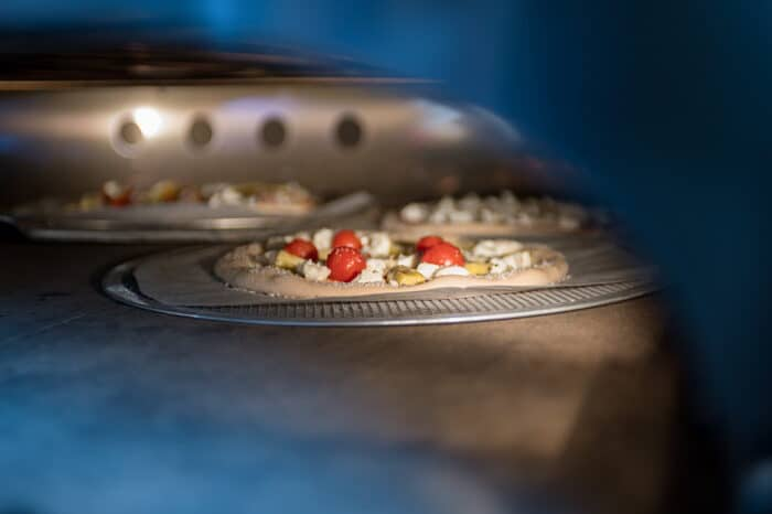 Pizzas baking in the oven