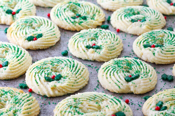 Finished butter spritz cookies decorated into Christmas wreath cookies