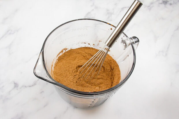 All of the dry ingredients for the chocolate whoopie pies in a mixing bowl after being whisked together.