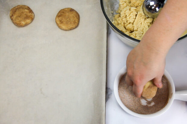 Scooping and rolling the dough in cinnamon and sugar for snickerdoodles