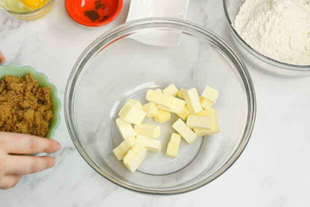 Cold cubed butter in a large bowl