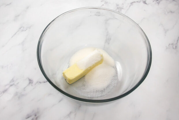 Butter and granulated sugar in a bowl for butter spritz cookies