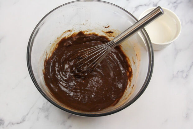 After mixing the eggs into the chocolate crinkle cookie dough. It is now smooth and thinner like a brownie batter.