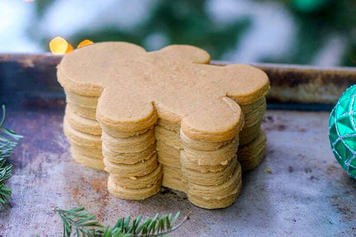 A stack of baked but not decorated gingerbread cookies