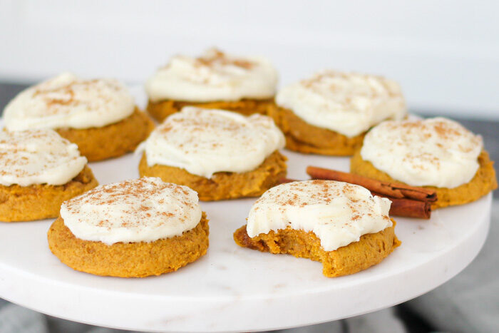Completed soft pumpkin cookies with cream cheese frosting on a serving platter