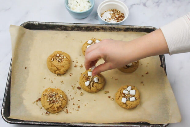 Topping the baked sweet potato cookies with marshmallows